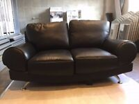 Sofa black leather two-seater, good condition.