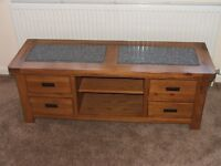Television unit with space for DVD, sky box and storage in solid wood with granite inset panels