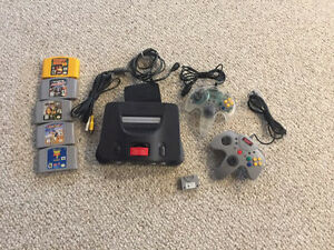 N64 , 2 controllers,5 games, expansion and memory paks