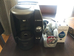 Tassimo Coffee Maker with a bunch of pods