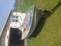 12ft deep hull boat, motor and trailer.
