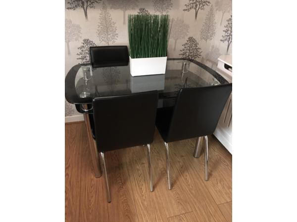 Glass table and 4 chairs SOLD