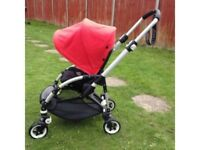 Bugaboo Bee Plus with red hood