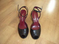 Black high-heeled leather shoes from Russell & Bromley (size 4).