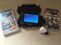PSP original with case and two games