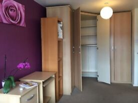 A very spacious bright double room is available with a massive storage space