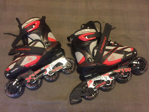 New never used adjustable roller blades size 2-4.5