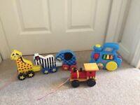 Selection of toys - wooden train, Melissa & Doug zoo pull along, push along sound train