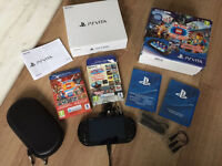 PS VITA WITH + 22 GAMES + ACCESSORIES