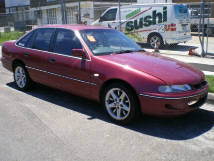 WANTED TO BUY RED VS COMMODORE SEDAN