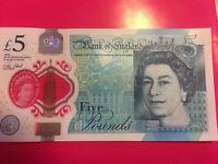 Five pound note. AK47