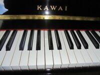 upright piano by kawai model kx10