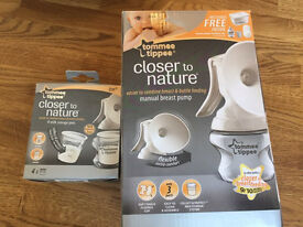 Brand new manual breast pump & extra milk containers