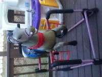 wooden rocking horse and a horse on springs