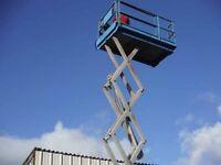 Scissor lift access platform. Genie GS-3268RT. All terrain access platform with work height 11.8m.