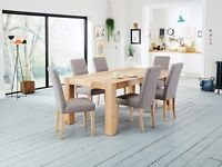 Nearly new dining table and 8 chairs
