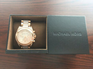 Micheal kors watch for ladies. Brand new. Best offer.