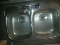 CLEAN DOUBLE STAINLESS SINK AND COUNTER TAPS MOEN