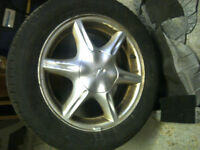 Four alloy rims with Uniroyal TigerPaw all season tires