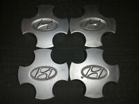Set of 4 OEM center caps for Hyundai Accent 1995 - 1999