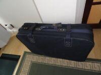 blue canvas type suitcase