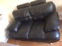 TWO SEATER BLACK LEATHER SOFA IN GOOD CONDITION.