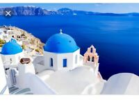 ***2 tickets to Santorini***