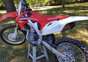 2010 Honda CRF 250 with Yoshimura exhaust.  Excellent condition.