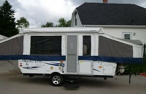 2012 Palamino Real Lite 1206 with slide and storage trunk