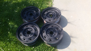 Four 14 inch steel rims in good condition