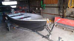 12ft tin boat and trailer with a 4hp Johnson for sale