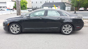 2015 Lincoln MKZ with under 12k km. Tech package, fully loaded.