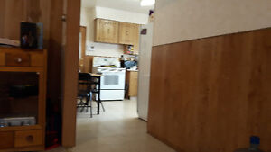2 bedroom plus den and double garage house for rent