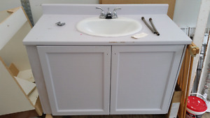 "43"" wide vanity with sink and taps."