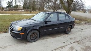 2005 Hyundai Accent, e-tested, 166kms, with set of snows on rims