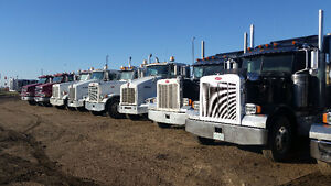 Pre owned gravel and high way tractors