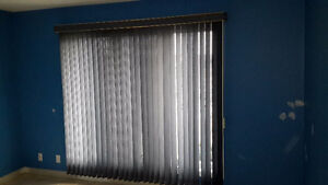Light blue vertical window blinds