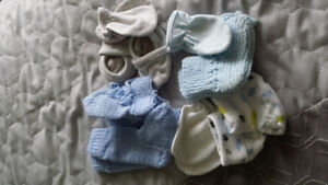 4 sets of booties and mitts