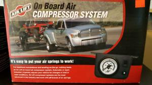On board air compressor system