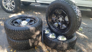New snow tires with rims, chrome caps and nuts to hold caps.