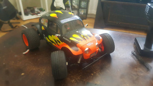 FOR SALE OR TRADE: 2 RC CARS BOTH READY TO RUN.