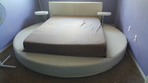 Luxury white leather bed.