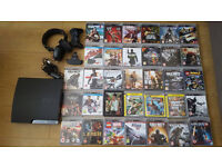 Playstation 3 bundle with 33 games and accessories