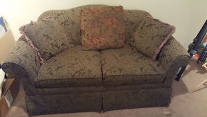 Love seat - sofa bed. Like new condition