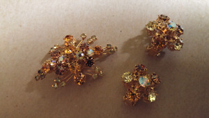 Vintage broach and clip on earrings.