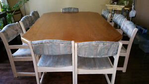 Palliser made 7'x5' dining table and 9 chairs
