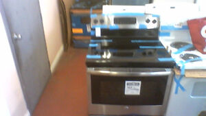30'' GE  S|C Smooth Top Stainless Steel Stove.