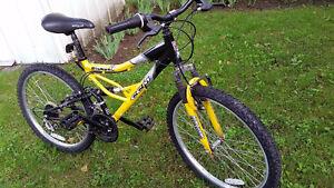 Vélo enfant tout suspendu, tres confortable à 21 vitesses