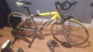 Giant OCR 3 small girls road bike and indoor trainer for sale.
