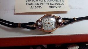 18kt gold womens diamond,ruby wrist watch working.